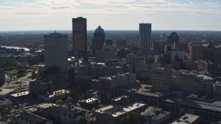 DX0002_208_013 - 5.7K stock footage aerial video descend with view of the city skyline, Downtown Rochester, New York