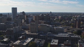DX0002_208_015 - 5.7K stock footage aerial video descend and flyby office buildings and parking garage, Downtown Rochester, New York