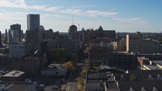 DX0002_208_019 - 5.7K stock footage aerial video flying by office buildings and parking garage by East Avenue, Downtown Rochester, New York