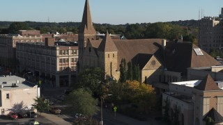 DX0002_208_024 - 5.7K stock footage aerial video orbit and fly away from a church in Rochester, New York