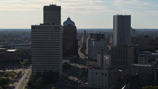 DX0002_208_031 - 5.7K stock footage aerial video of ascending past skyscrapers and office towers in Downtown Rochester, New York