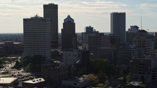 DX0002_208_033 - 5.7K stock footage aerial video of descending past skyscrapers and office towers in Downtown Rochester, New York