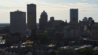 DX0002_208_034 - 5.7K stock footage aerial video ascend while focused on skyscrapers and office towers in Downtown Rochester, New York