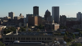 DX0002_209_001 - 5.7K stock footage aerial video of skyscrapers and office towers behind apartment building, Downtown Rochester, New York