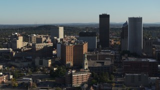 DX0002_209_003 - 5.7K stock footage aerial video orbit apartment building near high-rises, Downtown Rochester, New York