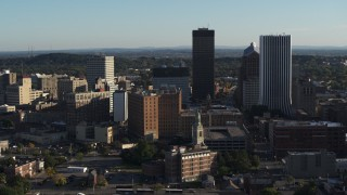 DX0002_209_005 - 5.7K stock footage aerial video circling an apartment building near high-rises, Downtown Rochester, New York