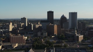 DX0002_209_009 - 5.7K stock footage aerial video of flying by apartment building and skyline, Downtown Rochester, New York