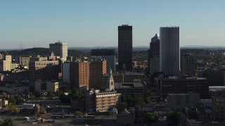 DX0002_209_010 - 5.7K stock footage aerial video of descending past apartment building and skyline, Downtown Rochester, New York