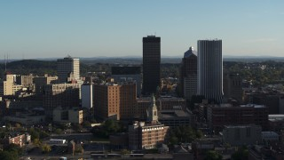 DX0002_209_011 - 5.7K stock footage aerial video of apartment building and skyline during ascent, Downtown Rochester, New York