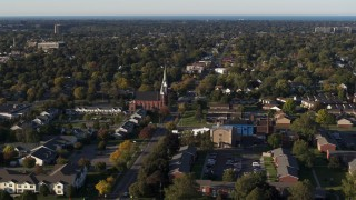 DX0002_209_017 - 5.7K stock footage aerial video wide orbit of brick church in Rochester, New York