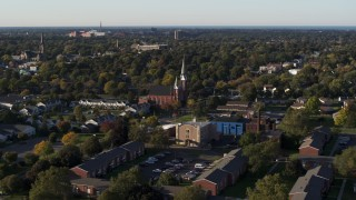 DX0002_209_018 - 5.7K stock footage aerial video slow orbit of brick church in Rochester, New York