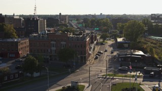 DX0002_209_022 - 5.7K stock footage aerial video of a brick office building and Central Avenue in Downtown Rochester, New York