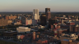 DX0002_209_028 - 5.7K stock footage aerial video of flying away from First Federal Plaza and office buildings at sunset, Downtown Rochester, New York
