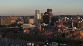 DX0002_209_029 - 5.7K stock footage aerial video of focus on First Federal Plaza, flyby office buildings at sunset, Downtown Rochester, New York
