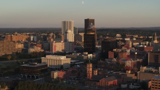 DX0002_209_031 - 5.7K stock footage aerial video orbit First Federal Plaza and office buildings at sunset, Downtown Rochester, New York