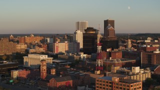 DX0002_209_032 - 5.7K stock footage aerial video orbit First Federal Plaza, office buildings, and a radio tower at sunset, Downtown Rochester, New York