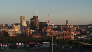 DX0002_209_034 - 5.7K stock footage aerial video circling a radio tower near First Federal Plaza at sunset, Downtown Rochester, New York