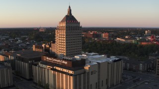 DX0002_209_036 - 5.7K stock footage aerial video fly away from college and Kodak Tower at sunset, Rochester, New York