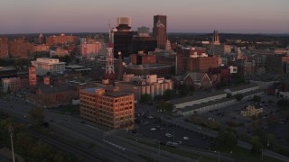 DX0002_209_050 - 5.7K stock footage aerial video of an orbit of a radio tower and office buildings at sunset, Downtown Rochester, New York