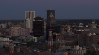 DX0002_210_006 - 5.7K stock footage aerial video of First Federal Plaza, radio tower, and Legacy Tower at twilight, Downtown Rochester, New York
