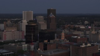 DX0002_210_007 - 5.7K stock footage aerial video focus on Legacy Tower at twilight during orbit of skyline, Downtown Rochester, New York