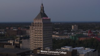 DX0002_210_009 - 5.7K stock footage aerial video orbit top of Kodak Tower at twilight, Rochester, New York