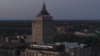DX0002_210_010 - 5.7K stock footage aerial video descend while focused on the top of Kodak Tower at twilight, Rochester, New York