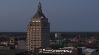 DX0002_210_011 - 5.7K stock footage aerial video fly away from Kodak Tower at twilight and descend, Rochester, New York