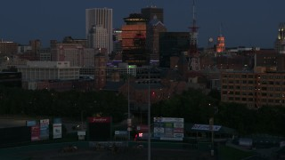 DX0002_210_015 - 5.7K stock footage aerial video of orbiting Spiritus Christi Church at twilight, Downtown Rochester, New York
