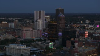 DX0002_210_016 - 5.7K stock footage aerial video of the city skyline behind First Federal Plaza at twilight, Downtown Rochester, New York