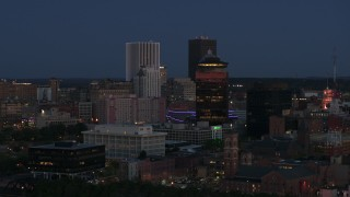DX0002_210_019 - 5.7K stock footage aerial video of flying by the city skyline behind First Federal Plaza at twilight, Downtown Rochester, New York