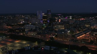 DX0002_210_022 - 5.7K stock footage aerial video flyby and approach the city's night at twilight, Downtown Rochester, New York