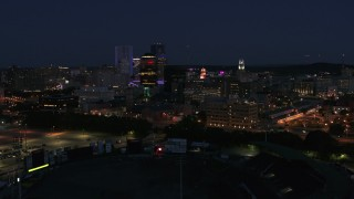 DX0002_210_025 - 5.7K stock footage aerial video of a wide orbit of the city's skyline at night, Downtown Rochester, New York