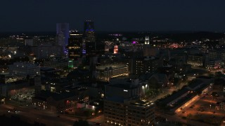 DX0002_210_028 - 5.7K stock footage aerial video ascend and orbit office buildings at night, Downtown Rochester, New York