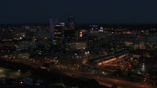 DX0002_210_030 - 5.7K stock footage aerial video of flying away from office buildings and skyline at night, Downtown Rochester, New York