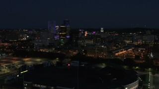 DX0002_210_031 - 5.7K stock footage aerial video of descending toward office buildings and skyline at night, Downtown Rochester, New York