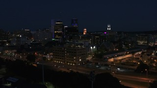 DX0002_210_032 - 5.7K stock footage aerial video descend while focused on office buildings at night, Downtown Rochester, New York