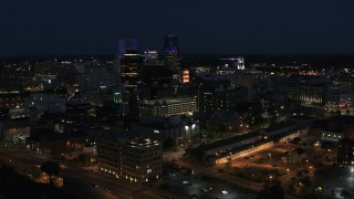 DX0002_210_033 - 5.7K stock footage aerial video ascend while focused on office buildings and skyline at night, Downtown Rochester, New York