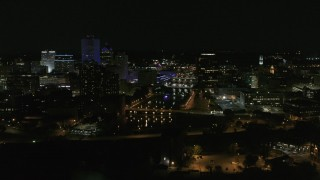 DX0002_210_038 - 5.7K stock footage aerial video of the Genesee River and skyline seen during ascent at night, Downtown Rochester, New York