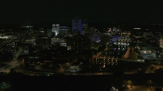 DX0002_210_039 - 5.7K stock footage aerial video stationary view of the Genesee River and skyline at night, Downtown Rochester, New York