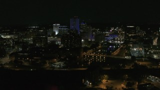 DX0002_210_040 - 5.7K stock footage aerial video of flying by the Genesee River and skyline at night, Downtown Rochester, New York