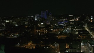 DX0002_210_041 - 5.7K stock footage aerial video of flying away from the Genesee River and skyline at night, Downtown Rochester, New York