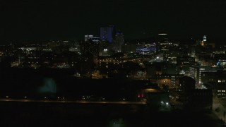 DX0002_210_042 - 5.7K stock footage aerial video of approaching the Genesee River and skyline at night, Downtown Rochester, New York