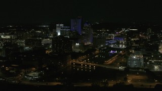 DX0002_210_043 - 5.7K stock footage aerial video of approaching the city's skyline beside the Genesee River at night, Downtown Rochester, New York