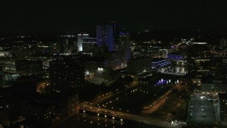 DX0002_210_044 - 5.7K stock footage aerial video of orbiting the city's skyline beside the Genesee River at night, Downtown Rochester, New York
