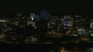 DX0002_210_046 - 5.7K stock footage aerial video of a wide orbit of city's skyline beside the Genesee River at night, Downtown Rochester, New York