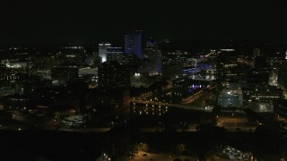 DX0002_210_051 - 5.7K stock footage aerial video of a reverse view of the Genesee River and skyline at night, Downtown Rochester, New York