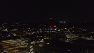 DX0002_210_052 - 5.7K stock footage aerial video orbit around Kodak Tower at night, Rochester, New York