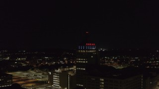 DX0002_210_053 - 5.7K stock footage aerial video of orbiting Kodak Tower at night, Rochester, New York