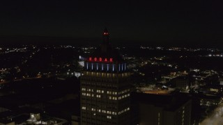 DX0002_210_054 - 5.7K stock footage aerial video of orbiting the top of Kodak Tower at night, Rochester, New York